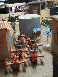 Orks ride into combat, going head-to-maw with the Daemons.