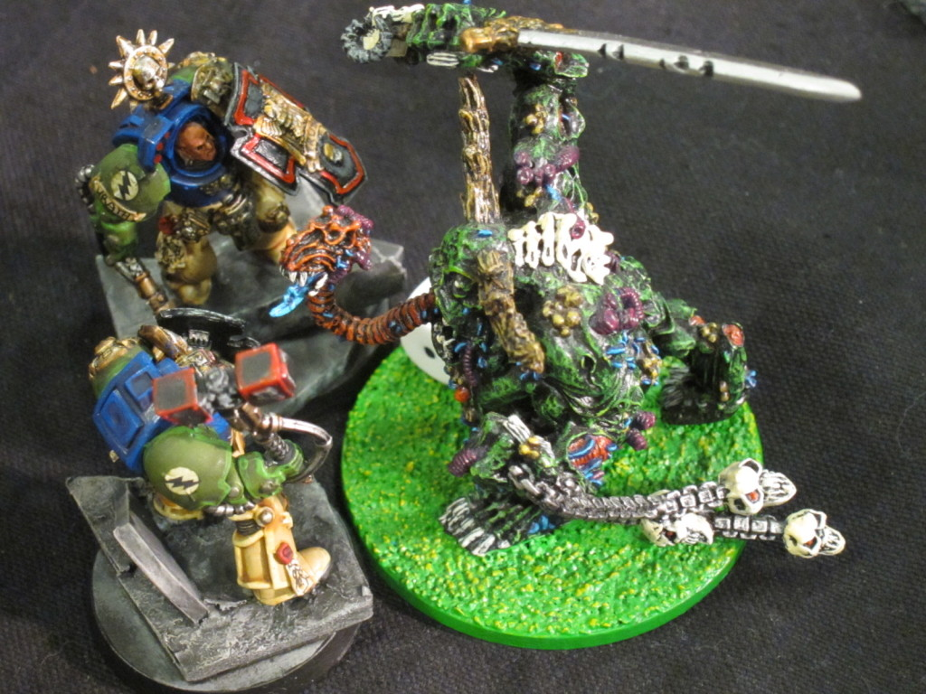 A Great Unclean One exchanges mighty blows with a Terminator Sergeant.