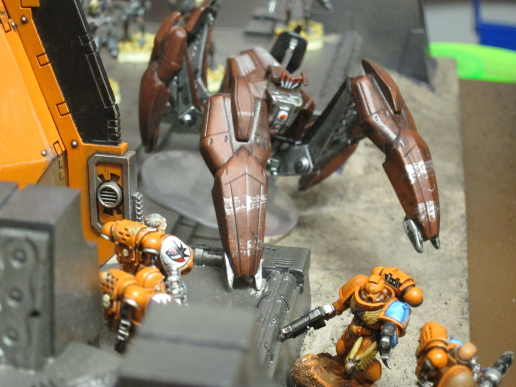 Necron constructs engage the Swords of Dorn deploying from their Drop Pods.