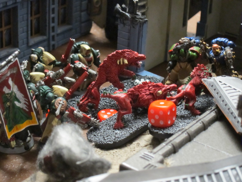 Kingbreakers Squad Harbinger and Dark Angels Tacticals work to purge the alleyways and rubble surrounding the Hab Blocks.