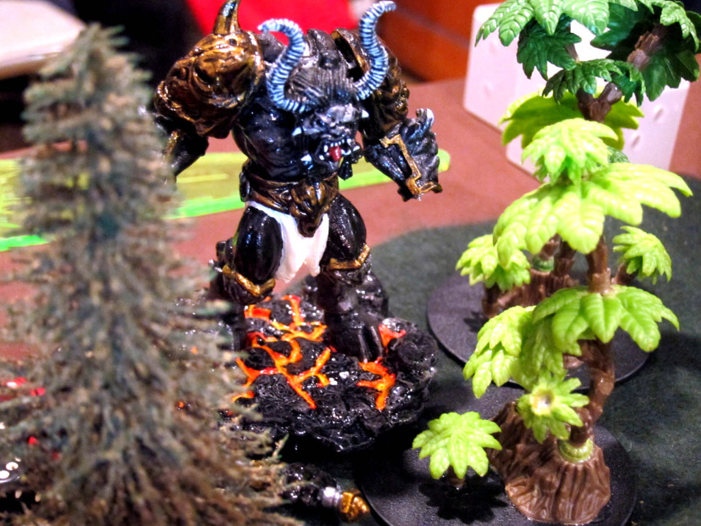A molten daemon lurks in the bushes.