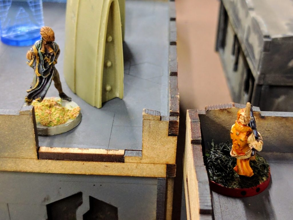 A Spec Sergeant pops up from camo in a desperate attempt to clear off the center building.