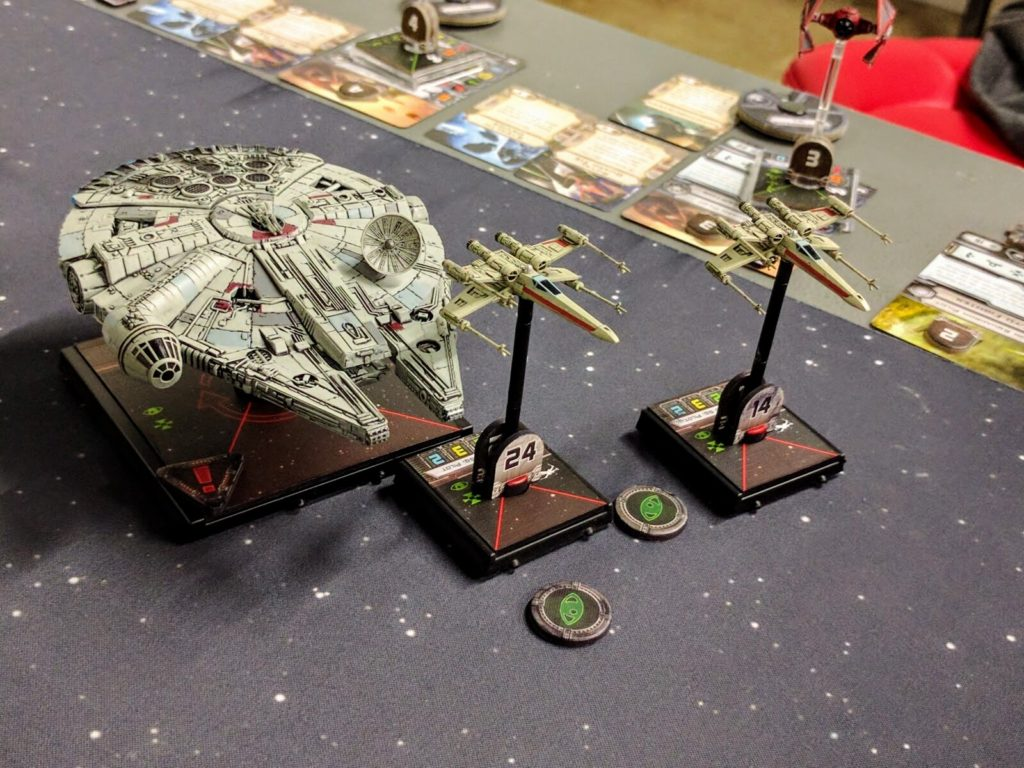 A pair of original trilogy X-Wings and Chewbacca patrol the outer rim.